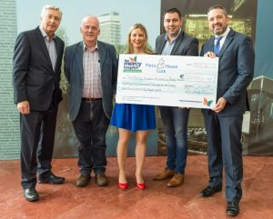 """Former Mayor Cllr. John Paul O' Shea presents the Mercy Hospital Foundation and Pieta House, Cork with the proceeds from the """"Hooley in the Hall""""."""