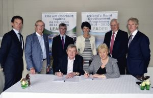 The Minister for Arts, Heritage, Regional, Rural and Gaeltacht Affairs, Heather Humphreys TD, signing the first batch of Funding Agreements under the LEADER Programme 2020. The Minister said the €250 million programme will support hundreds of jobs across rural Ireland. The agreements are being signed with Local Action Groups from around the country at an event in the Virginia Show Centre in Cavan, which previously benefitted from €500,000 in LEADER funding. Funding of €250 million will be distributed to entrepreneurs and community groups throughout Ireland by the Local Action Groups, which are made up of public and private representatives. The LEADER programme funds projects under a diverse range of themes that include enterprise development, rural tourism, social inclusion and the environment. The programme is co-financed by the European Agricultural Fund for Rural Development. The previous LEADER programme delivered almost 10,000 projects throughout rural Ireland. In addition to supporting community-based projects, last year LEADER funding supported over 800 enterprises and 500 jobs. Minister Humphreys is pictured with Aidan Gleeson; Sean Hegarty; Niall Healy; Tom Stritch; Padraig Casey and seated: Gerard Murphy all of North Cork LEADER Local Action Group. Photo: Brian Mulligan
