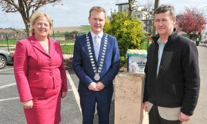 Cllr Seamus McGrath, Mayor of the County of Cork, with Cork County Council director of services Mary Ryan and Kevin O'Regan, Municipal District Officer, at the countywide launch of the Cork County Council, Streetscape Painting, Signage & Improvement Scheme, in Passage West. Picture: David Keane.